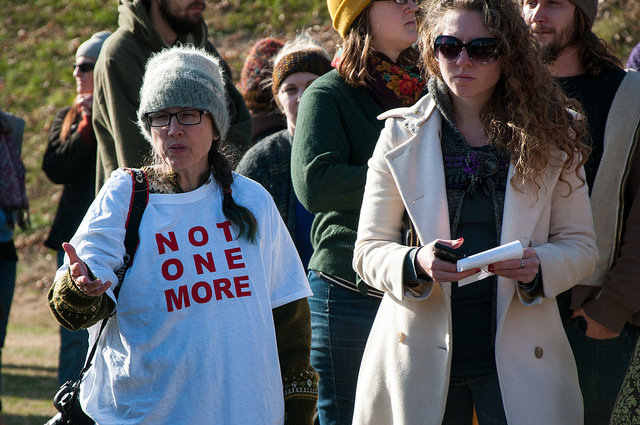 A group of women protest Phi Kappa Psi at the University of Virginia after a Rolling Stone article uncovered an alleged gang rape and other sexual assaults on campus.