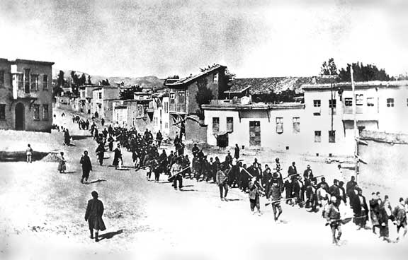 Armenians are marched to a nearby prison in Mezireh by armed Turkish soldiers. Kharpert, Armenia, Ottoman Empire, April, 1915.