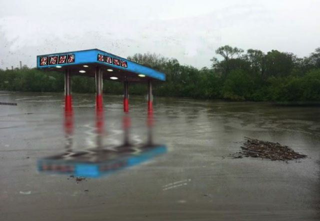 "A rendering of Mia Feuer's proposed public art piece, ""Antediluvian,"" a sunken gas station sculpture in the Anacostia River."