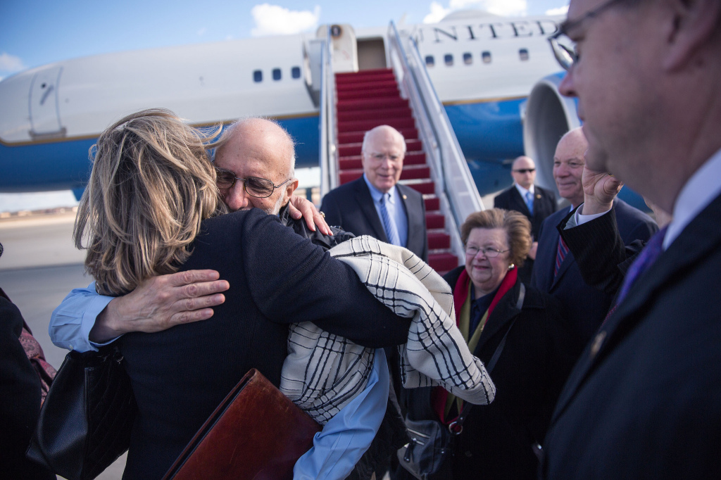 Gross is greeted with hugs after arriving at Joint Base Andrews in Maryland on Wednesday.