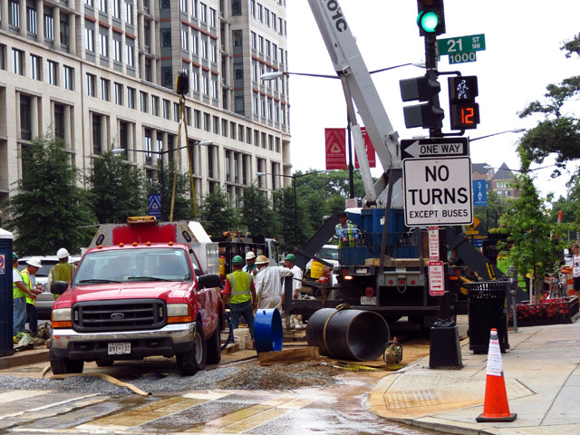 A crew works on water infrastructure near the intersection of 21st and K streets in 2012.