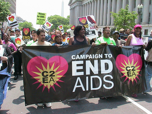 Members of the Campaign to End AIDS march to the White House to demand an end to the global AIDS pandemic.
