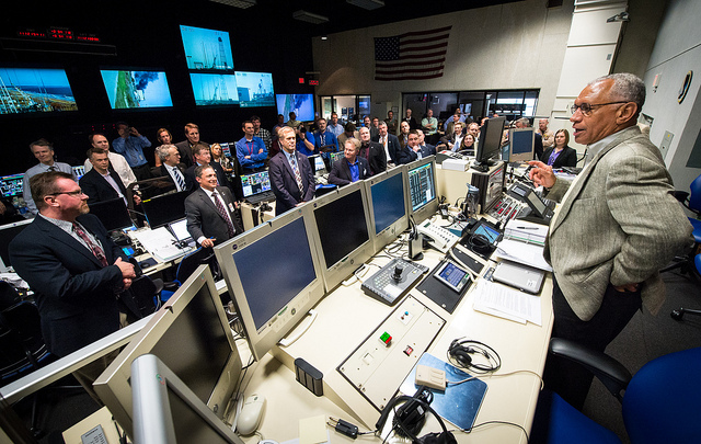NASA Administrator Charles Bolden congratulating the launch team after the launch of Antares.