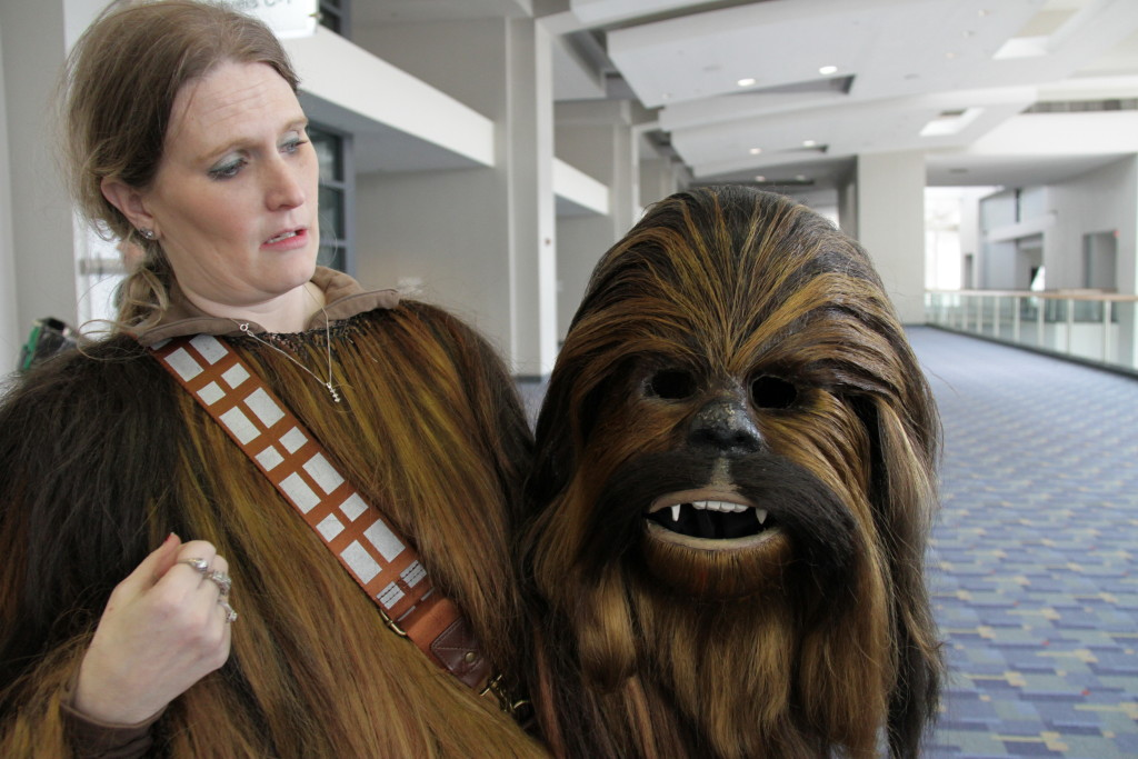 Cosplayer Gretta Koplen Hayden holds the Chewbacca mask her husband Jason constructed.