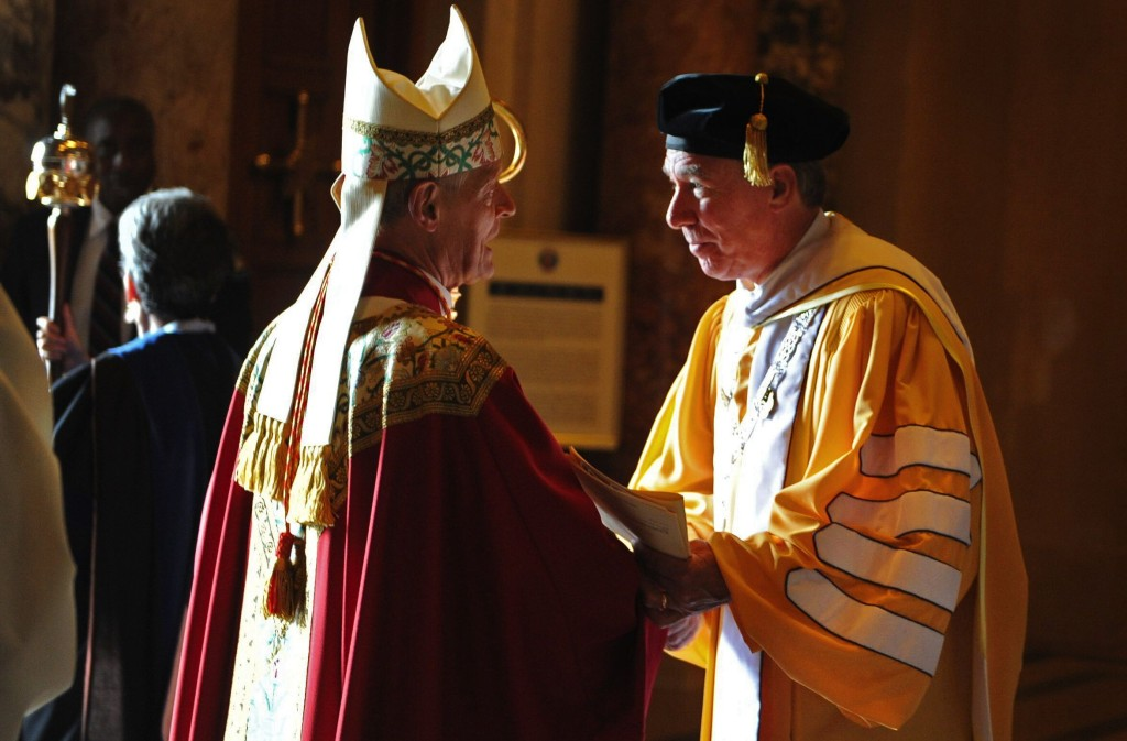 John Garvey, right, President of The Catholic University of America, greets Cardinal Donald Wuerl, archbishop of Washington and University chancellor, at the Basilica of the National Shrine of the Immaculate Conception after the University's annual Mass of the Holy Spirit to celebrate the opening of the school year.