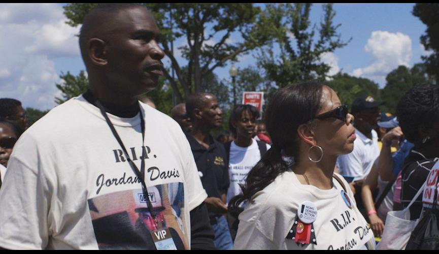 3 ½ MINUTES, TEN BULLETS IMAGE 6 – Ron Davis and Lucia McBath at Rally