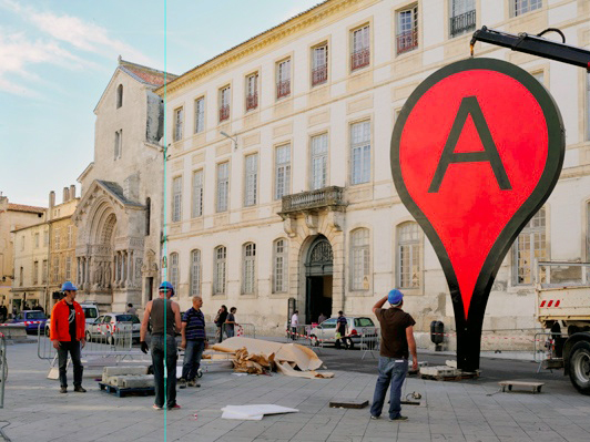 """Aram Bartholl's project """"Map"""" is a public space installation that incorporates Google Maps' big red pin."""
