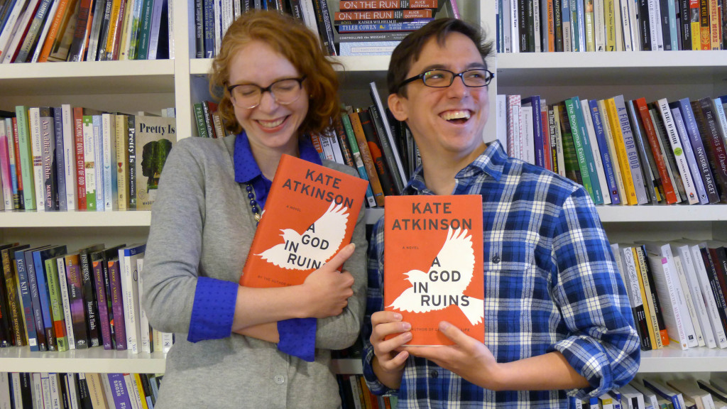 """Kojo Show producer Tayla Burney (left) and WAMU web producer Chris Chester (right) pose with """"A God In Ruins,"""" one of Burney's summer reading picks and a feature of this year's Morning Edition Book Club."""