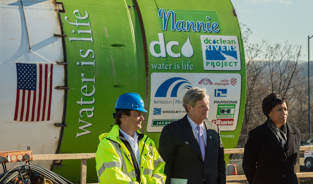 D.C. Water General Manager George Hawkins (left) at a 2015 event with Agriculture Secretary Tom Vilsack (center) and Washington, D.C. Mayor Muriel Bowser (right).