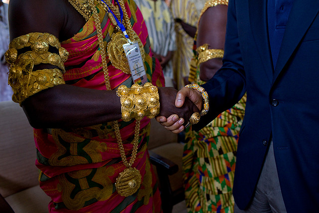 President Barack Obama shakes hands on a 2009 tour of Cape Coast Castle in Ghana.