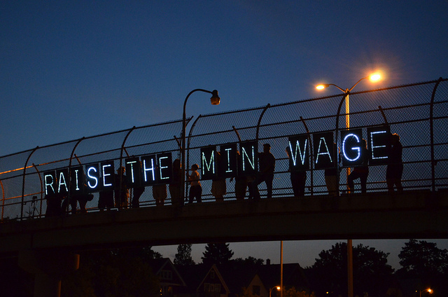 Wisconsin activists for raising the minimum wage display their message on an overpass.