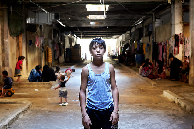 Syrian refugee Mahmoud, in the underground shelter where he lives with his family in El Akbiya, Lebanon in 2013.