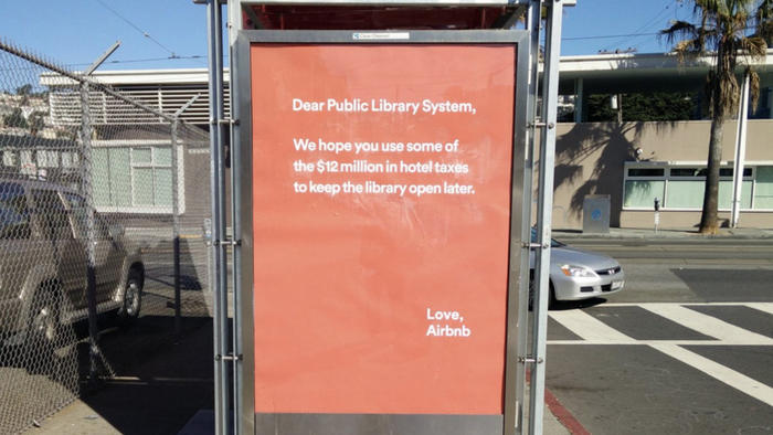 An AirBnB ad at a  San Francisco bus stop protesting the city's imposed hotel tax.