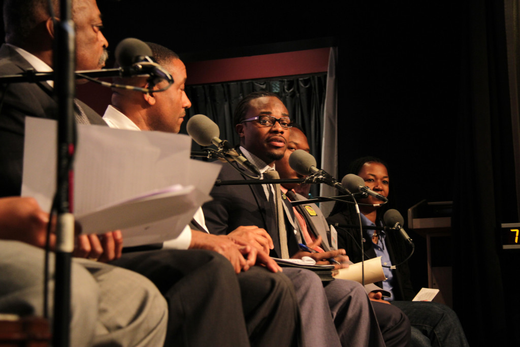Maryland State Delegate Alonzo Washington (center) on stage at Busboys & Poets in Hyattsville, Md.