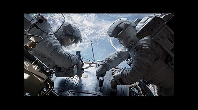 "Sandra Bullock and George Clooney in ""Gravity."""