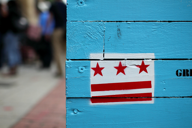 The Washington D.C. flag on a planter on H Street, NE.