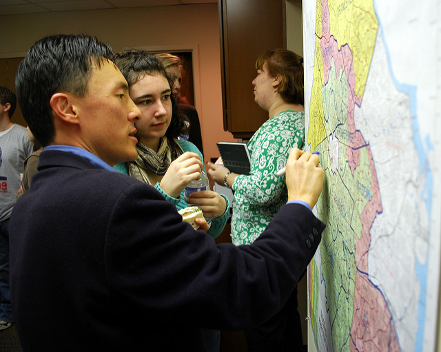 Then-candidate Mark Keam draws his district on a map at his campaign kickoff event in Vienna, Va.
