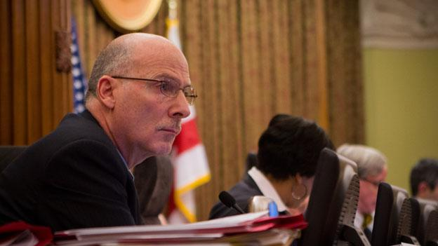 D.C. council chairman Phil Mendelson sitting at the council's dais in 2012.