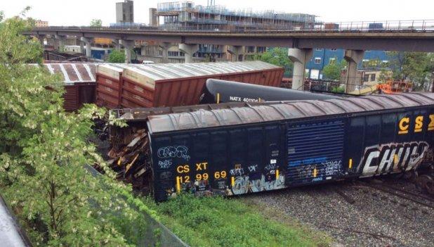 The derailment of a CSX train caused a sodium hydroxide leak and shutdown the Rhode Island Avenue area near the tracks Sunday.