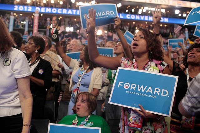 Delegates react to President Barack Obama's speech during the closing night of the 2012 Democratic National Convention held at the Time Warner Cable Arena in Charlotte, North Carolina.