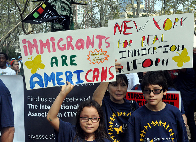 "More than 2,000 people marched over New York City's Brooklyn Bridge on October 5, 2013 demanding ""real"" immigration reform."