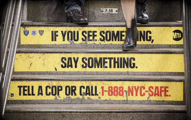 A public safety sign in a New York City MTA station.
