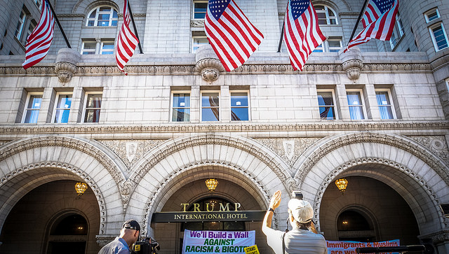 Protesters denounce Donald Trump outside the Trump International Hotel on the day of its soft opening.