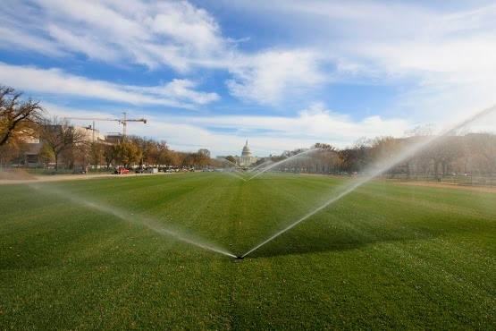 The $40 million renovation of the National Mall includes a programmable irrigation system that throws water 90 feet across the grass.