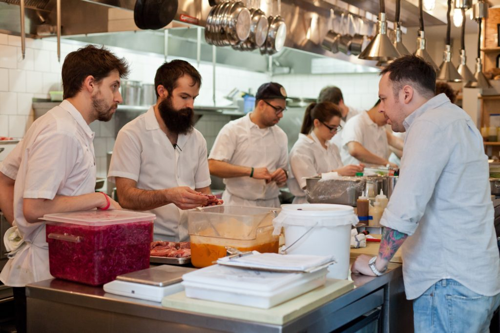 Chef Aaron Silverman in the kitchen with staff at Rose's Luxury