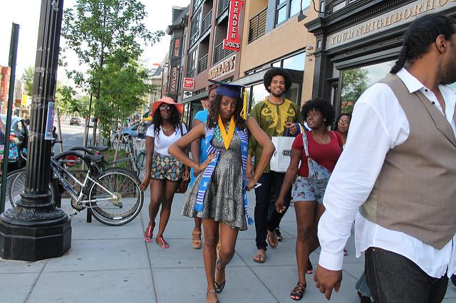 A Howard University Class of 2015 graduate struts down 14th Street in Northwest D.C.