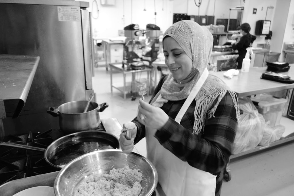 Foodhini's Chef Ghosoun, a recent refugee from Syria, prepares dishes in the startup's Ivy City kitchens, located at the local food incubator Union Kitchen.