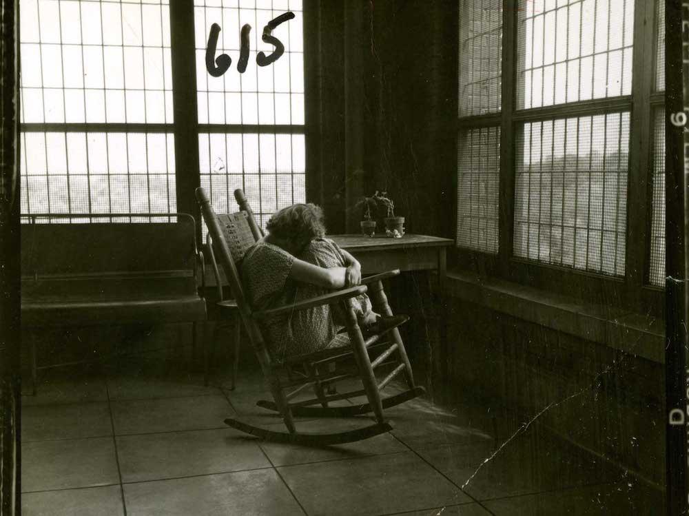 Saint Elizabeths patient on a rocking chair in 1955.