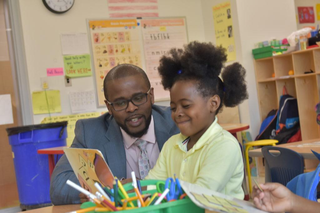D.C. Public Schools Chancellor Antwan Wilson talks to a student during a school visit.