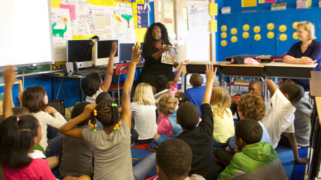 Teacher Lisa Jones speaks to students at Watkins Elementary School.