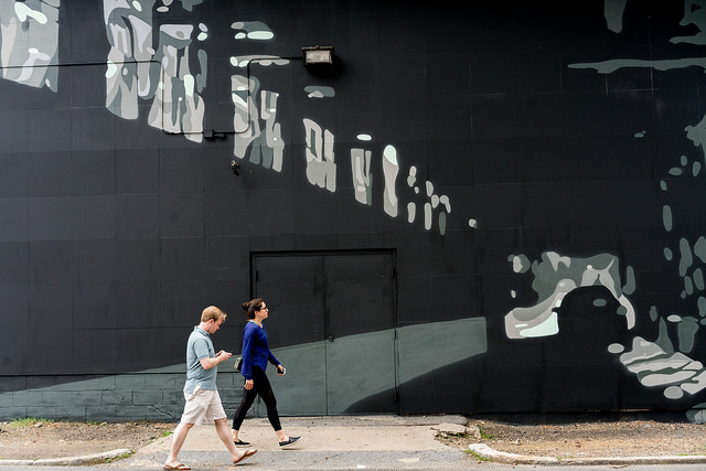 Pedestrians pass a new mural on Patterson Street in D.C.'s NoMa neighborhood.