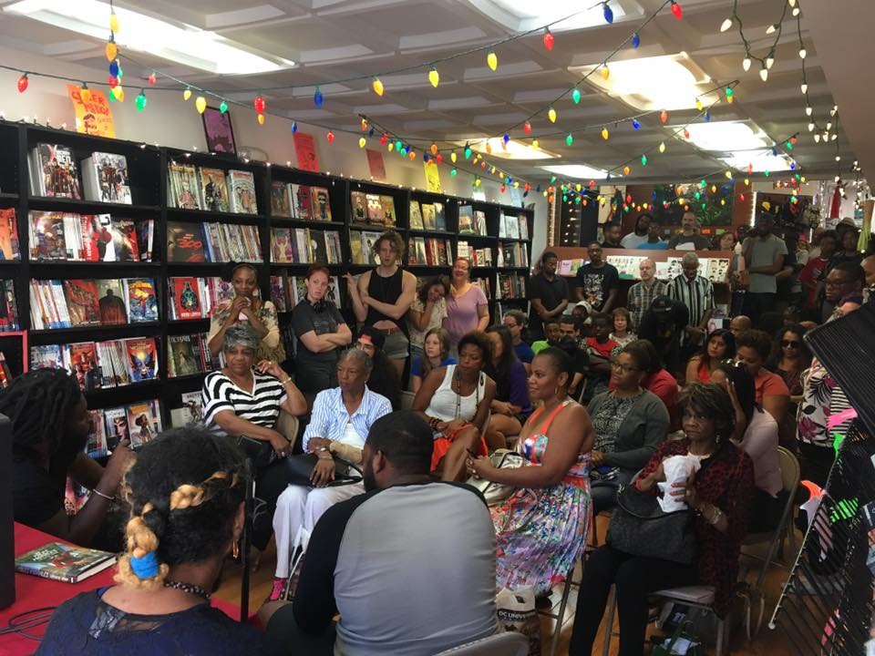 A book club gathering at Fantom Comics.