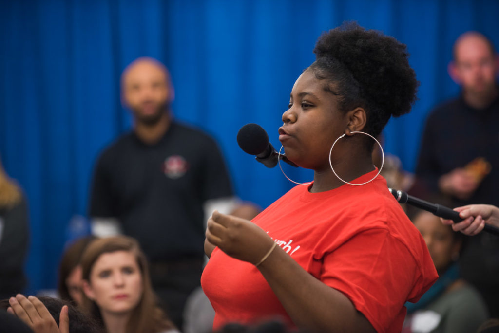 A student speaks at the WAMU student town hall.