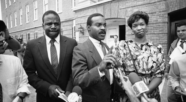 Wayne Curry, center, leaves the Prince George's County courthouse in Upper Marlboro, Maryland, Aug. 14, 1986 with clients James and Lonise Bias after the pair appeared before a grand jury investigating drug use and scholastic problems at the University of Maryland brought on by the death of their son basketball star Len Bias.