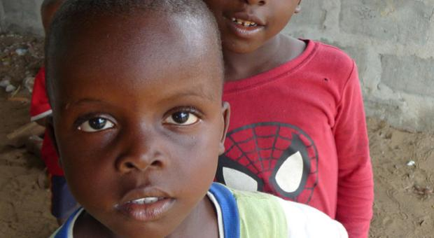 Children on the grounds of the Liberian Institute for Biological Research