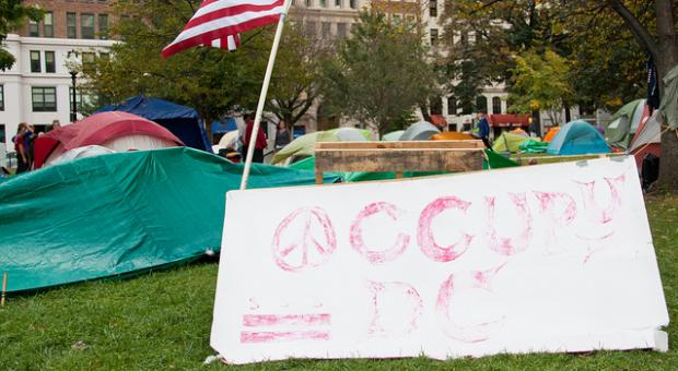 2nd week of Occupy D.C., in McPherson Square. The sign is almost completely faded.
